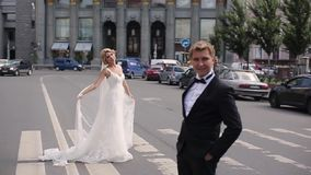 Wedding couple in a city. Wedding couple walking in a city stock video
