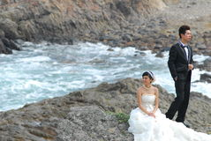 Wedding couple at cliff Stock Photography