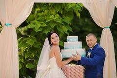 Wedding couple couple holding gifts. Happy Wedding couple holding gifts royalty free stock photos