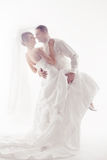 Wedding couple dancing. And happy smiling. Bride and groom portrait. Over white royalty free stock photography