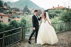 wedding couple dancing against the backdrop of the mountains stock photo