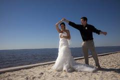 Wedding couple dancing on beach stock photo
