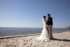 Wedding couple dancing on beach Royalty Free Stock Photography