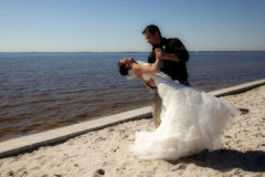 Wedding couple dancing on beach Stock Photos