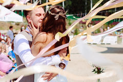 Wedding couple dancing and kissing Royalty Free Stock Image