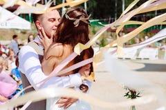Wedding couple dancing and kissing Royalty Free Stock Image