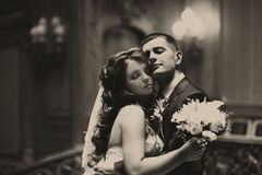 Wedding couple daydreams in the old hall Stock Photos