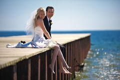 Wedding Couple on Dock stock images