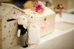 Wedding couple dolls. On the reception desk Stock Photo