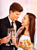 Wedding couple drinking champagne Royalty Free Stock Photos