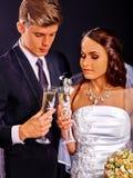 Wedding couple drinking champagne Stock Image