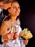 Wedding couple drinking champagne. royalty free stock photography