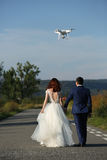 Wedding couple and drone Royalty Free Stock Images