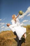 Wedding couple in eared field Royalty Free Stock Photography
