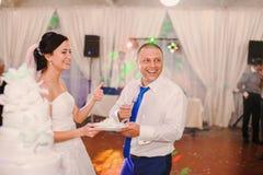 Wedding couple eating cake Stock Photo