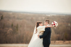 Wedding  couple embracing on open spaces of hills Stock Photo