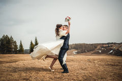 Wedding  couple embracing on open spaces at winter Stock Image