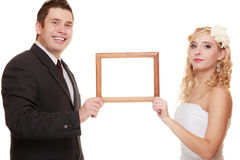 Wedding couple with empty frame for photos. Stock Photography