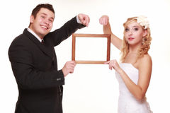 Wedding couple with empty frame for photos Stock Image