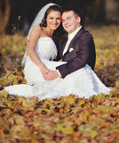 Wedding couple enjoing in autumn forest. Royalty Free Stock Photo