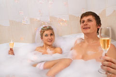 Wedding couple enjoying in bath Stock Image