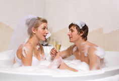Wedding couple is enjoying a bath Stock Image
