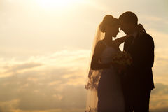 Wedding couple in the evening. Peaceful romantic moment. Royalty Free Stock Images