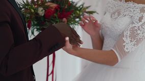 Wedding couple exchanging the rings. Wedding exchange rings, the bride black, bride European stock video footage