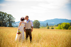 Wedding Couple in Field Royalty Free Stock Images