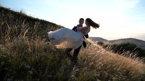 Wedding couple in the field stock footage