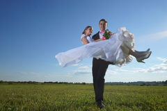 Wedding couple on field Stock Image