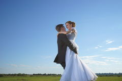 Wedding couple on field Stock Images