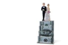 Wedding couple figurines on US dollar banknote. Against white background stock images