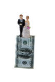 Wedding couple figurines on US dollar banknote. Against white background royalty free stock photos