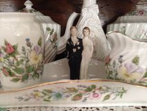 Wedding couple and fine china Stock Photo