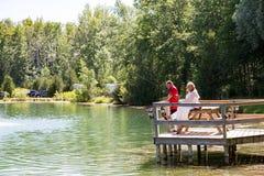 Wedding couple fishing on dock Royalty Free Stock Photography