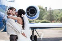 Wedding couple fly on honeymoon Royalty Free Stock Photos