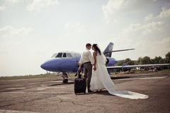 Wedding couple fly on honeymoon Stock Photos