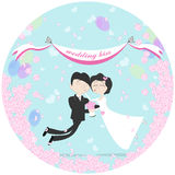 Wedding couple flying. Wedding couple flying in the air between clouds. Marriage kiss. Birds holding banner. Happy young family. Honeymoon Stock Photo