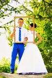 Wedding couple in the frame Royalty Free Stock Photos