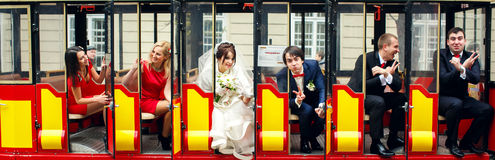 Wedding couple and friends sit in the tourist tram.  Royalty Free Stock Photos