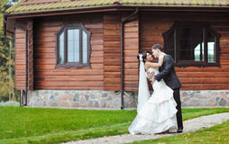 Wedding couple in front of big house in a park Stock Photography