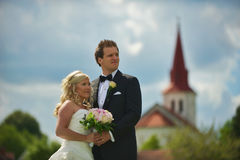 Wedding couple in front of church Royalty Free Stock Photo