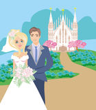 Wedding couple in front of a church Stock Image