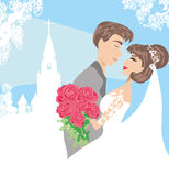 Wedding couple in front of a church Royalty Free Stock Images