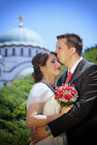 Wedding couple in front of the Temple of Saint Sava Stock Image