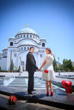 Wedding couple in front of the Temple of Saint Sava Royalty Free Stock Photography