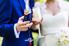 Wedding couple with glasses Stock Photos