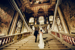 Wedding couple goes upstairs in an old theatre in Vienna.  Stock Images