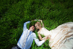 Wedding couple in grass Royalty Free Stock Image